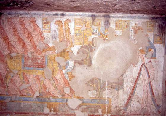 Relief scene showing Queen Tyti in a gesture of adoration before the goddess, Hathor, in her form as 'Cow of the West' (Source: OsirisNet).