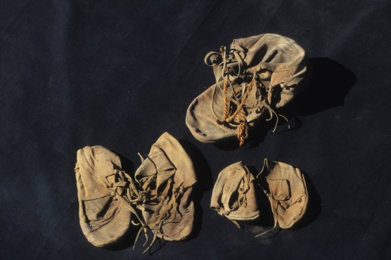 The unwrapped shoe bundle showing the two pairs of children's shoes and the adult isolate (Source: Live Science).