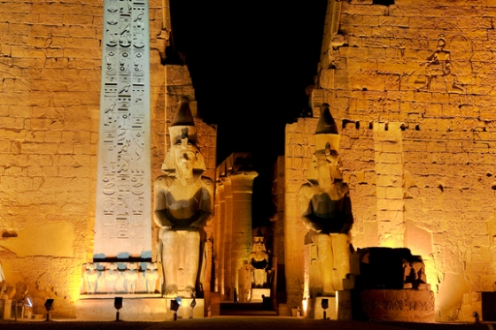 A red granite obelisk and two seated statues of Ramesses II guard the entrance to the Luxor Temple (Source: LiveScience).